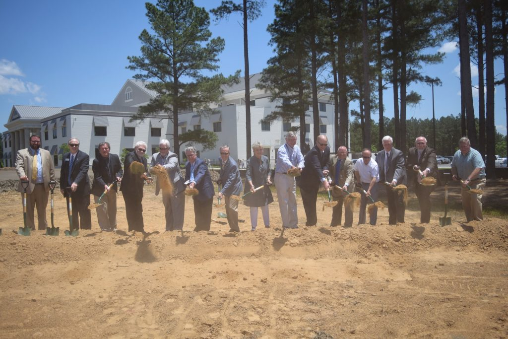 ACHE Board members and vice presidents break ground on new facility.