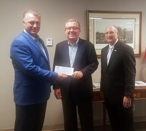 Mr. Mike Richardson, Arkansas Regional President, (left) and Scott Teague, Regional Commercial Banking Manager, (right), both of US Bank, present a $5,000 check to AICU President Rex Horne (center).