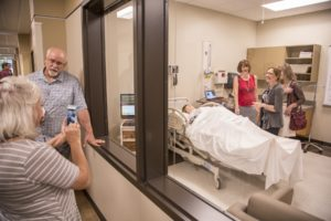 JBU faculty and staff, as well as the community of Siloam Springs, toured the Health Education Building and got a chance to see the exam rooms with High-Fidelity Simulators that imitate urgent care scenarios. The five interactive mannequins can simulate everything from heart attacks to giving birth, providing nursing students with hands-on educational experience.