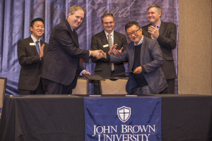 JBU President Chip Pollard and Handong Global University Dean Doo-Pil Kang shake hands after signing a memorandum of understanding for a  new partnership between the two institutions. Also pictured (L to R): JBU Assistant Professor of Engineering, Ted Song,  JBU Vice President of Student Development, Steve Beers and Headmaster of HGU's Carmichael College, Nick Lantinga.