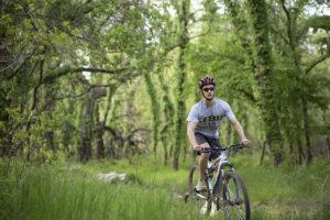 JBU student, Justin Riffel, rides on JBU's new mountain bike trail, where the inaugural Ricochet Run will be held on Sept. 24.