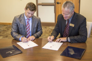 Morrison and Ericson Sign Agreement