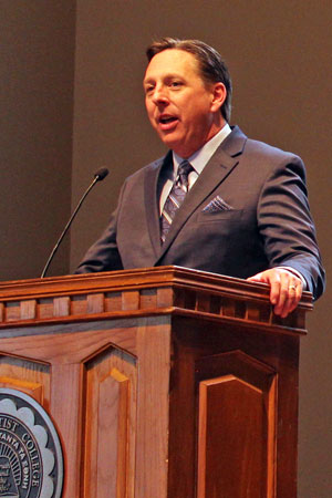 Dr. Stan Norman speaking Friday at his introduction in Manley Chapel