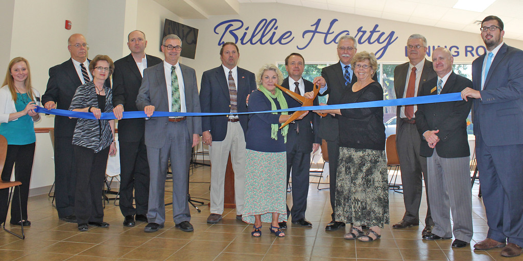 Cutting the Ribbon. Left to right: Hailey Thompson (junior from Pine Bluff, Ark.), Dr. Walter Norvell (associate professor of Christian ministries), Kathy Bradley (executive assistant, Lawrence County Chamber of Commerce), Jeff Herron (Brackett-Krennerich Architects), Dennis Owens (Fresh Ideas), C.L. Clark (Clark General Contractors), Maria Tolbert Chamberlain (associate of Harty family), Dr. Tom Jones (WBC president), John Harty, (nephew of N.B. Harty), Sue Lee, (daughter of N.B. Harty), James Miller (chairman of WBC board of trustees), Tim Scott (director, Randolph County Chamber of Commerce) and Mike Dixon (junior from Paragould, Ark.).
